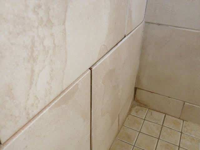 Fix loose tile in shower or bath
